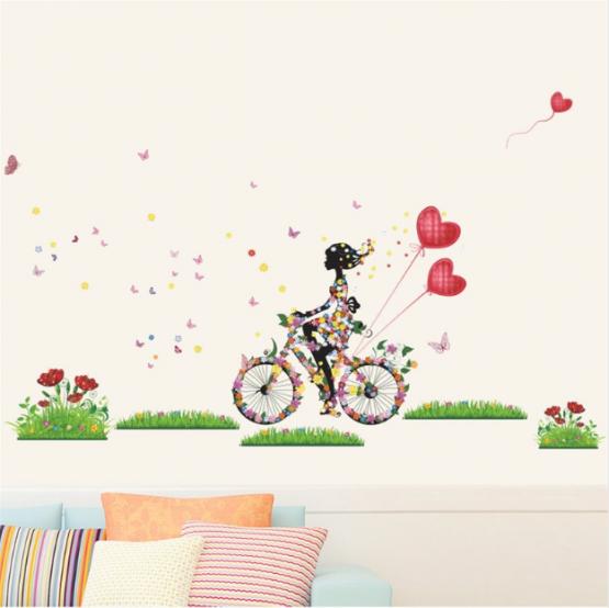 muursticker-meisje-op-fiets-met-vlinders